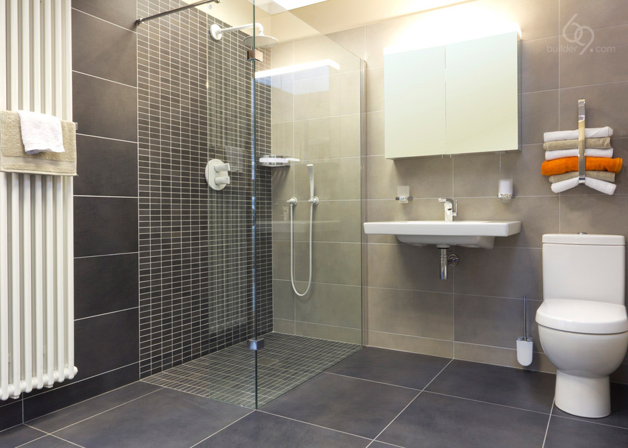A clean fresh modern shower room with wc basin mirrored cabinet and shower enclosure